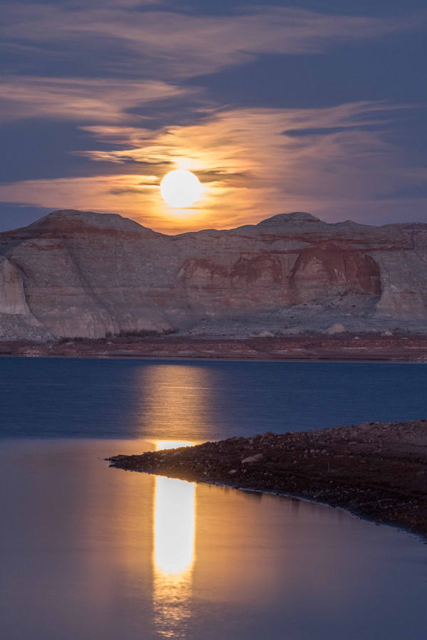 Beautiful night image of a moon cresting over the cliffs of Lake Powell. - photo by Gary Ladd