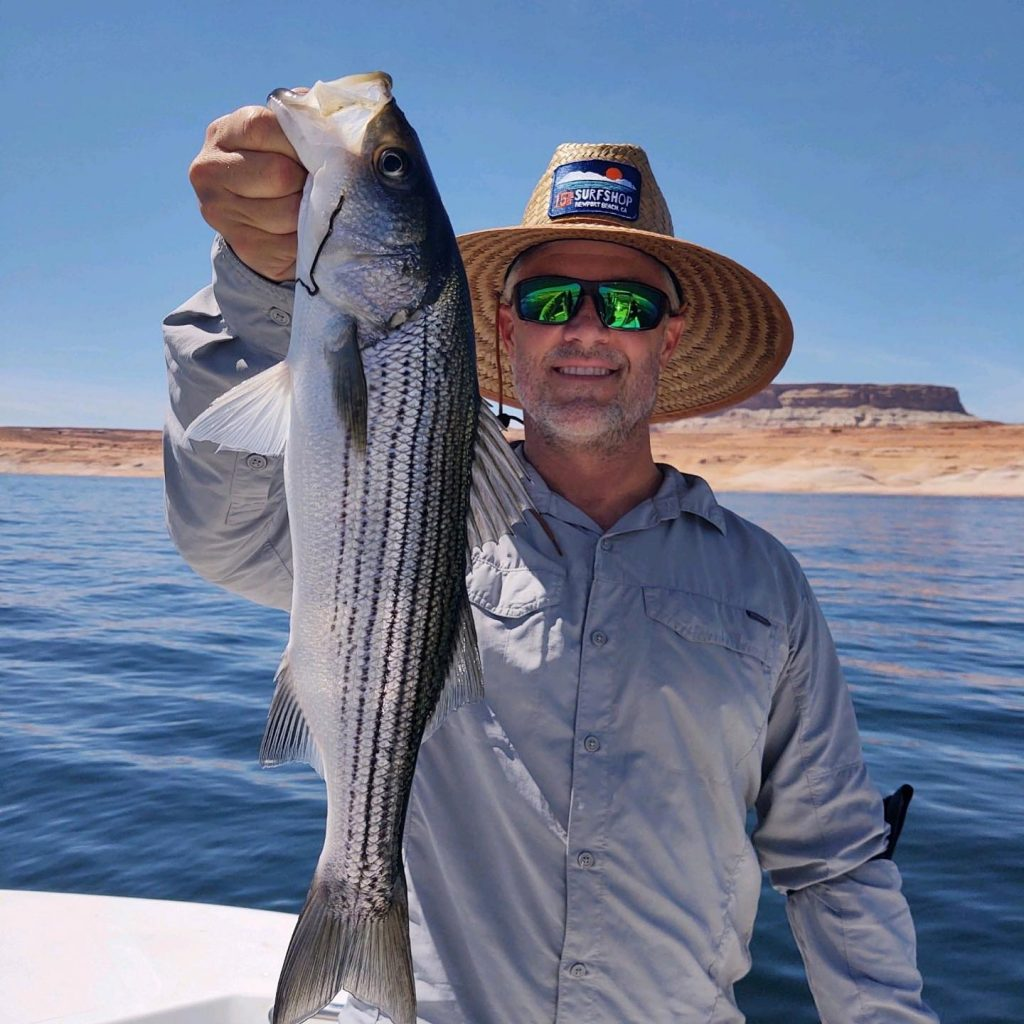 "This guy was pretty happy with his catch.  Lake Powell Fishing the ""best"""