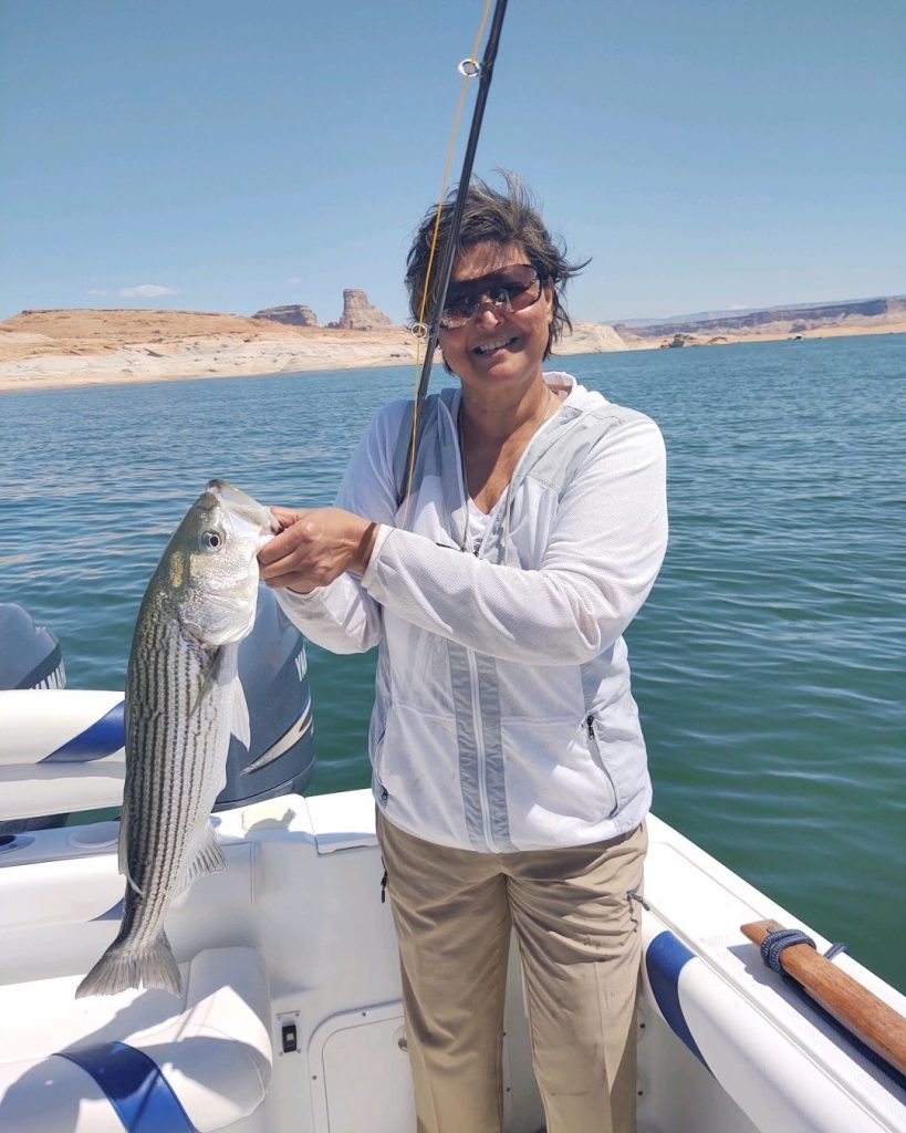 Reshma first time ever fishing lands a 6lb. Striper on the Flyrod!  A true natural.  5/27/21