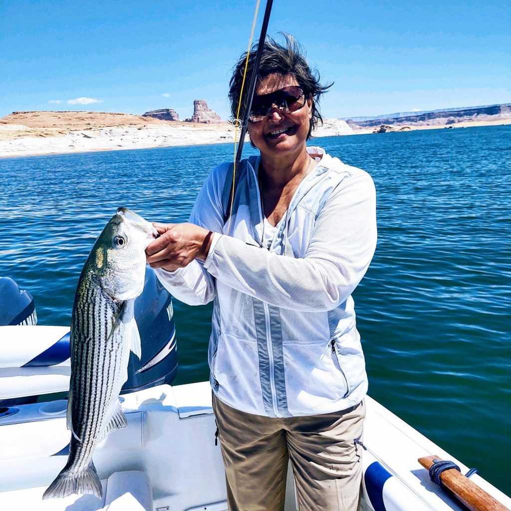 Reshma her first ever fishing trip and wanted to learn to Fly Fish!  Caught this nice 6 lb. Striper along with many others.  Let us show you Fly Rodding at Lake Powell.  Call 928-606-5829